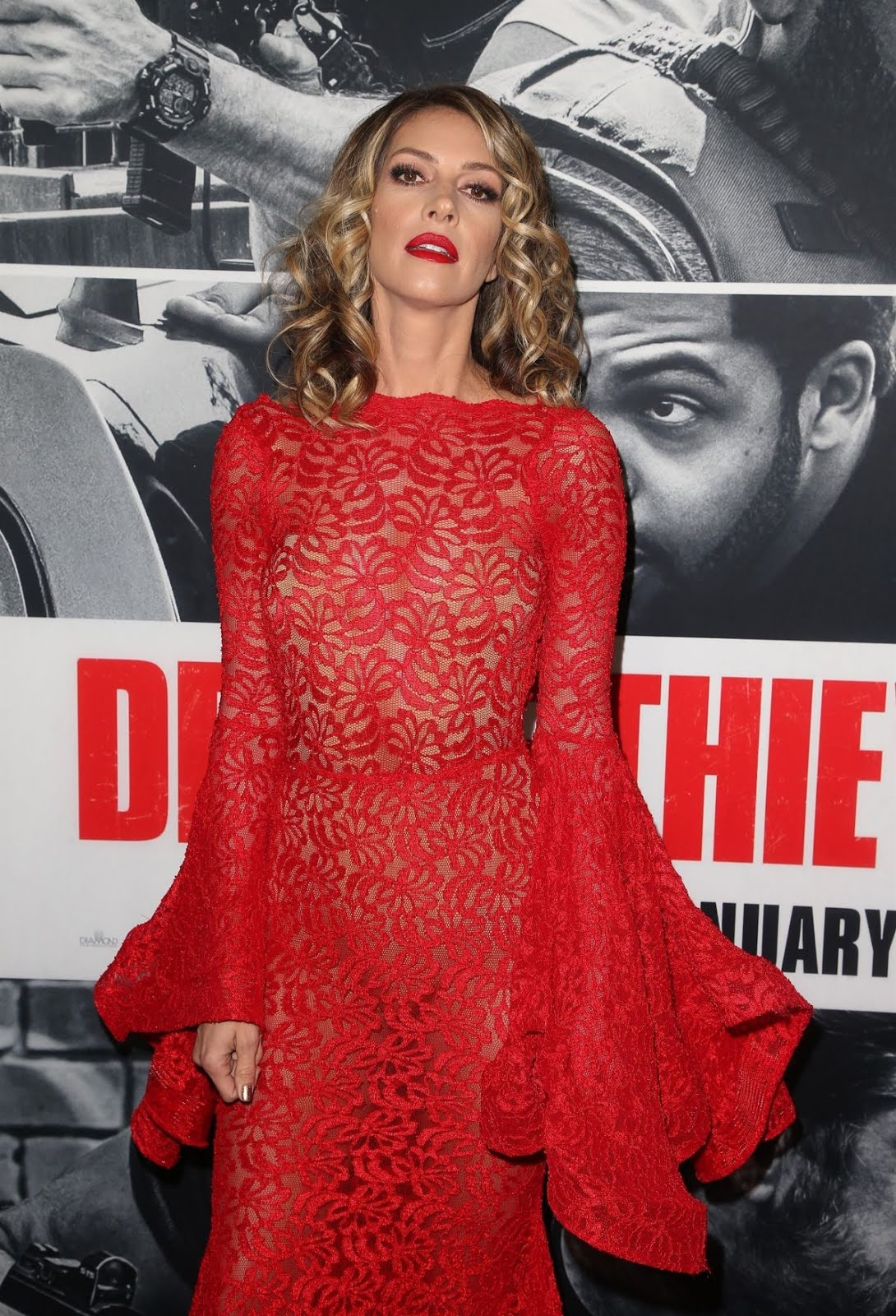 Dawn Olivieri in Hot Red Dress At Den Of Thieves Premiere In Los Angeles