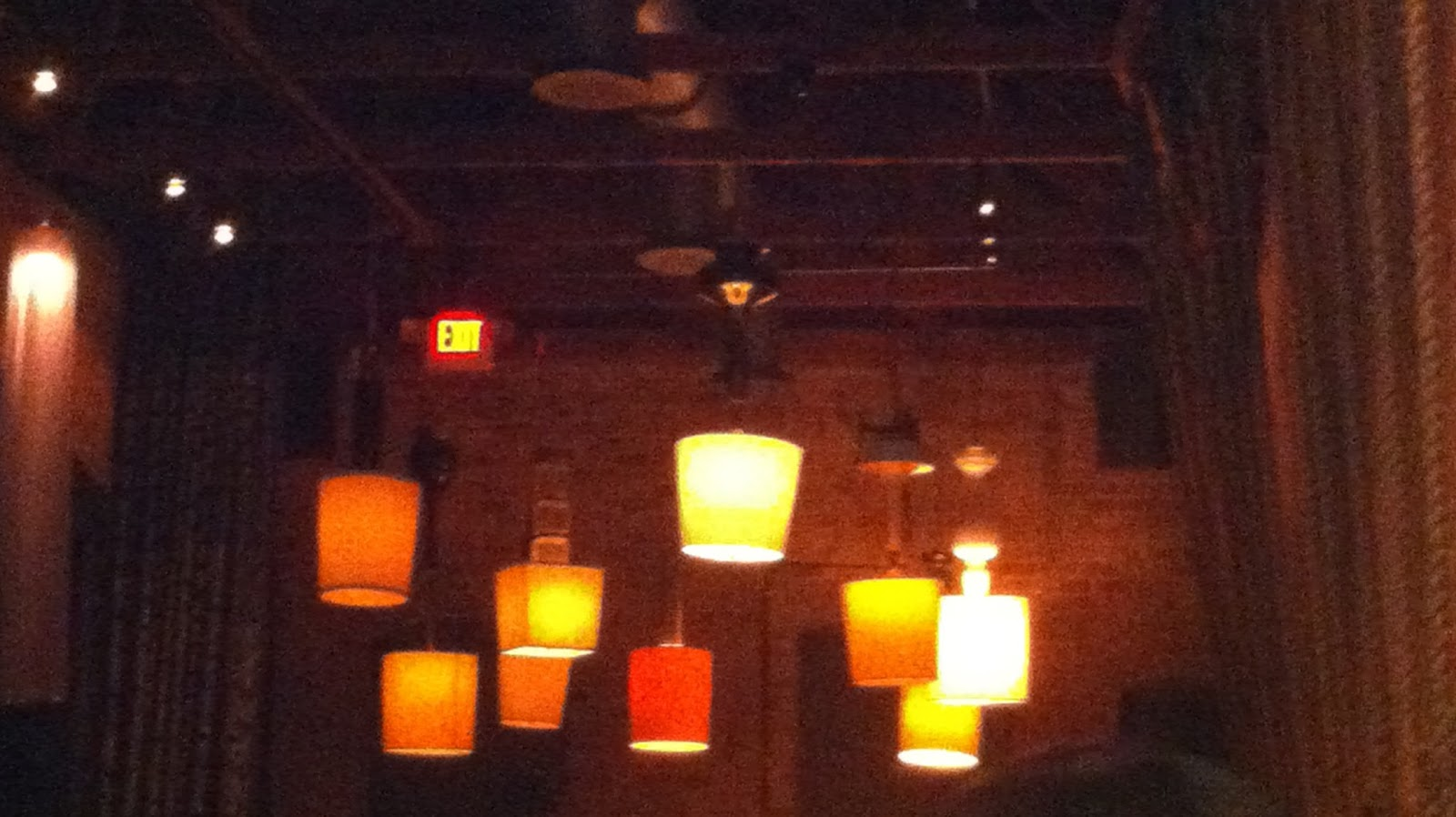 The lighting fixtures hanging from the ceiling in the hub restaurant in downtown tucson are regular old table lamps that have been installed upside down