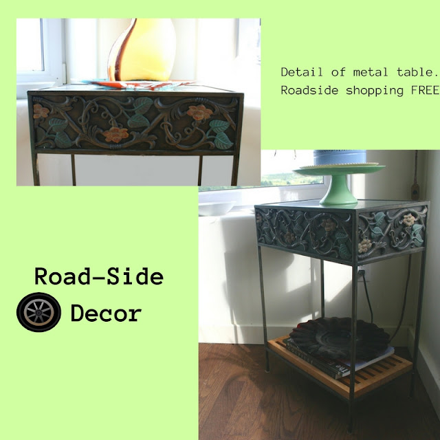 Metal table with painted metal molding & glass top.