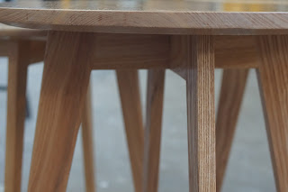 Close up of two coffee tables with round tops.