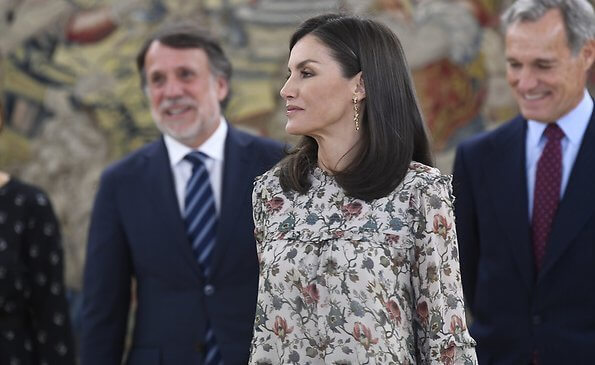 Queen Letizia received representatives of SOS Children's Villages of Spain and Atresmedia. Indi and Cold floral print blouse