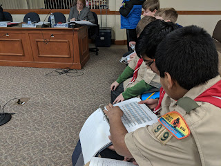 Franklin boy scouts from Troop 99 reviewed the school budget book  during the School Committee meeting Tuesday, Mar 27