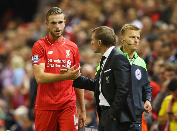 Jordan Henderson of Liverpool shakes hands with Brendan Rodgers manager of Liverpool as he is substituted during the Barclays Premier League match between Liverpool and A.F.C. Bournemouth at Anfield on August 17, 2015 in Liverpool, United Kingdom