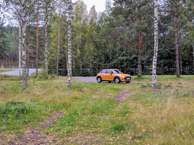 Yellow mini car at a rural rest stop on a Southeastern Finland road trip itinerary