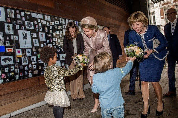 Queen Mathilde of Belgium and Daniela Schadt, partner of German President meet students of the Antwerp Fashion Academy during a visit to the MoMu fashion museum