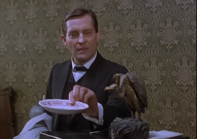 "Jeremy Brett (in Granada's ""The Speckled Band"") with the saucer of milk"