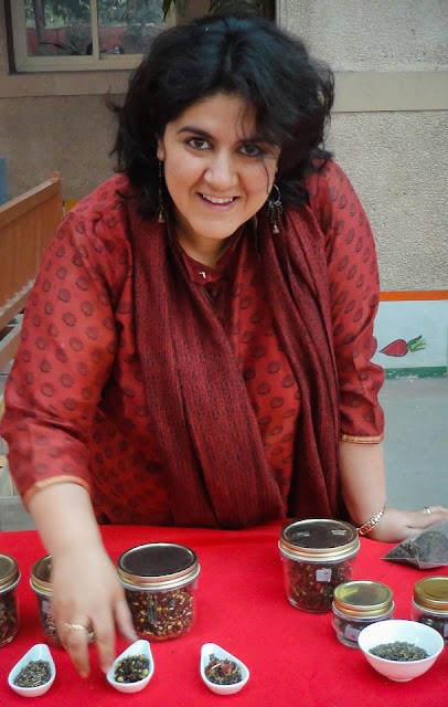 A Tea drinker by birth and a Tea-Taster by profession, Anamika Singh has introduced new infusions with a mix of natural flowers and herbs to the Indian market. Having launched her own brand 'Anandini Himalaya Tea', she conducts Tea tasting ceremonies, conferences & events in Delhi. Her real love is Tea. 'Identifying, understand and tasting tea we celebrate the very event of drinking tea! Sharing this knowledge with hospitality professionals & clients of real tea is a far bigger challenge'. Anamika brings on the table knowledge and passion in a delicious brew. Anamika Singh has spent over fifteen years in the tea industry. Starting in Darjeeling as an apprentice under her father, Mr. A. K. Singh (a world renowned tea specialist), she now invests a greater part of the year in the family owned tea gardens in Himachal Pradesh. Research & development in her workshop helps bring out the finest nuances of tea manufacturing and blending. Anamika's expertise extends to food pairing as part of the sensorial journey to culinary ecstasy.  Navigating between Dharamshala and Gurgaon has allowed her to keep in touch with her traditional 'purist' roots as well as the rapidly evolving international market of demanding expats and the Indian tea 'connoisseurs'. Working in collaboration with exclusive Spas, Star hotels and top restaurants Anandini HT has helped her to be part of this taste revolution. Anamika fires the mindset of  'chaiwallahs' with her dynamic personality and persistence in quality products and presentations. Anandini Himalaya Tea was born as the dream daughter of one of the finest tea producers of India. Anamika Singh, the founder, has taken the whole process of tea manufacturing towards the modern day tea drinking with 'blends'. They entice you into sharing this divine liquid with breakfasts, lunches, teatime snacks and even dinners. Inspiring blends have been created using the finest real teas and merging with Himalayan flowers and herbs as well as delicate spices from south India. Attached to the roots nurtured by Shri Abhai Singh for over 40 years 'Anandini' marks the evolution towards a consumer friendly palate with an international twist. Sprawled across 650 acres, this bio-diverse tea plantation was begun by the early British planters, over a century ago. It nestles comfortably on the lap of the mighty snow-capped Dhauladhar ranges in the Kangra region of the Himalayas. Like a maestro, this jewel occasionally pulls a veil of mist around it when working on its masterpiece, the First Flush.Kangra district is situated in the Northwest Indian state of Himachal Pradesh. The mountainous region has dramatic landscapes ranging from pine tree-covered slopes to snow covered sub Himalayan mountain range and deep gorges and streams that path their ways in to the valleys and one such is the Manjhee stream which flows along side the Manjhee Valley Tea Garden.  As in all creative cycles there is a starting point and the end result. At the point of balance the beginning and the end merge leaving no trace of either. Great 'Blends' follow a similar path to attain Divine Balance! Green Tea, Pomegranate flowers and Himalayan TulsiThe red pomegranate petals charms its way into the Green Tea liquor with the intense, strong earthy Himalayan Tulsi. The result is love at first sip. It increases healthy metabolism along with the antioxidant potency, which is more then two, or three times of red wine. It compliments crepes with chocolate sauce drizzled over it accompanied with sliced bananas or waffles with fresh fruits or a bowl full of muesli or sprouted lentils with chopped tomatoes, cucumber and fresh coriander.   Green Tea, Rhododendron flowers and Himalayan TulsiGrandeur of Himalayas in every sip.  When each leaf, has melted snow seeped in, Spring greets you in the cup. The delicate flaming red tangy Rhododendron flowers from the high altitude lofty Himalayas mingle gently with the sweet Himalayan Tulsi. The immune booster green tea when blended with the stress reliever Rhododendron petals and Himalayan Tulsi creates the happiness quotient that helps you sail through the day. It supports immunity and strength and stamina and is perfect at 10am. Accompanied with a chocolate chip cookie or a sliced crisp apple it enhances the flavors of tea while leaving an after taste of sweetness.  Or just a piece of dark chocolate..First Flush Tea with Lavender & Lemon GrassA cup of Happiness with whiffs of Serenity ... An exquisite First Flush radiant in cup amalgamates with the fragrant Lavender and the enticing Lemon grass to form the romantic trio. It eases of stress and anxiety. The citral in the refreshing lemon grass has a strong anti microbial and anti fungal properties and is also a detoxifying agent. The calming lavender is a good source of Vitamin A, Calcium and Iron. With bite full of French macaron or a fresh fruit tartlet or a delectable pear and chocolate frangipane tart, traditional Swiss roll or a caramel shortbread of Anzac biscuits, it compliments the flavors.  Green Tea with Chamomile and Rose HipThe sweet intense smoothness of the Chamomile creates a sip of dreams along with the slightly tangy bits of Rose Hip.  Infused into the green tea, it leaves you with a sense of calm. With a warm honey glow and sweet floral notes, the shining star in the nutrition and wellness sector, Green Tea has a higher concentration of antioxidants and bioactive substances. Rose Hip contains 50% more Vitamin C then oranges and blueberries. When sipped after dinner, it eases of stress and tiredness. It compliments a chocolate soufflé or almond ricotta cheesecake or tiramisu.Method of InfusioFor 1 cup (200ml): In a pot add 1 teaspoon of Anandini Blend. Pour 1 cup of water (200 ml) heated at 95 degrees C. over the Blend. Infuse for 4 minutes. Strain and Sip.Check out more about Anamika and her brain-child Anandini Himalayan tea http://www.hindustantimes.com/Entertainment/Food/Tea-trail/Article1-922654.aspxhttp://www.dailypioneer.com/vivacity/86686-secret-of-the-leaves.htmlhttp://www.youtube.com/watch?v=b8vnH2X1-FE&feature=sharehttp://healthfooddesivideshi.blogspot.in/2012/08/tea-with-anamika-singh-when-master-tea.htmlhttp://www.mytastycurry.com/2012/08/tea-tasting-and-food-pairing-event-by.html?fb_action_ids=4556295904914&fb_action_types=og.likes&fb_source=aggregation&fb_aggregation_id=246965925417366http://deyatanu.blogspot.in/2012/09/afternoon-teaand-something-more.html