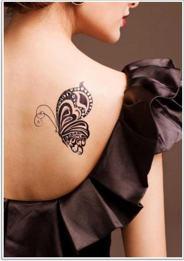 siyah taşlı kelebek dövmesi