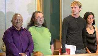 Image of the four defendants in court.