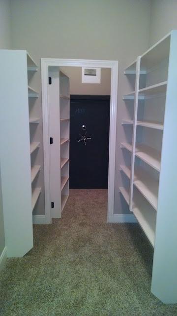 Built-In Shelving and Open Hidden Door