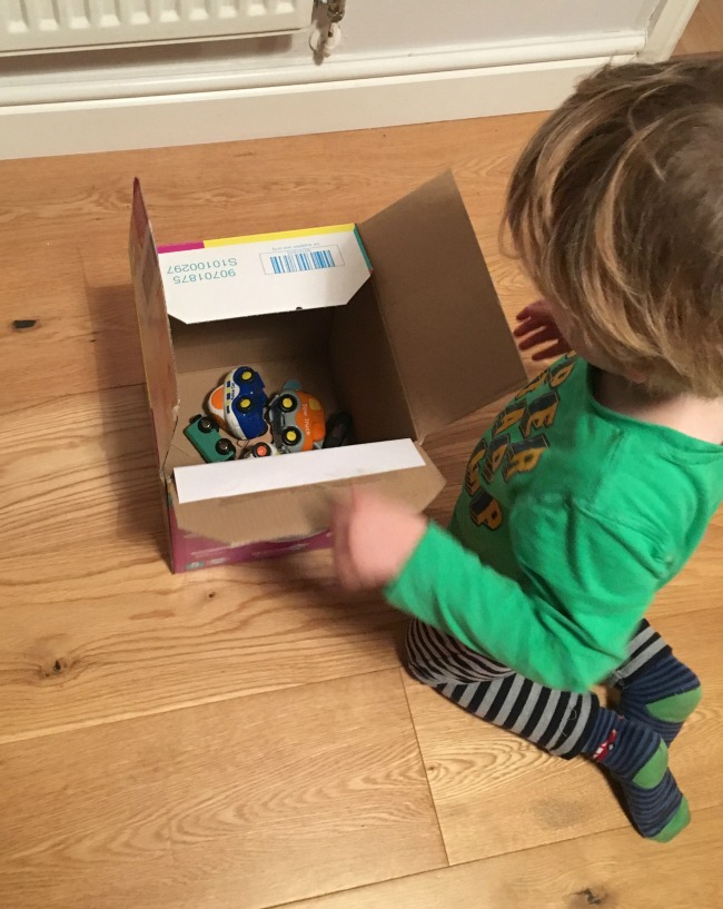 10-five-minute-games-for-toddlers-image-of-toddler-playing-with-cars-in-a-box
