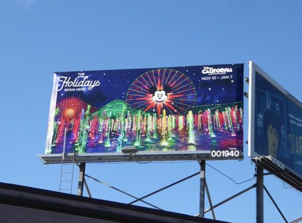 Holidays begin here Disney park billboard
