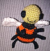http://www.ravelry.com/patterns/library/buzzy-the-amigurumi-bee