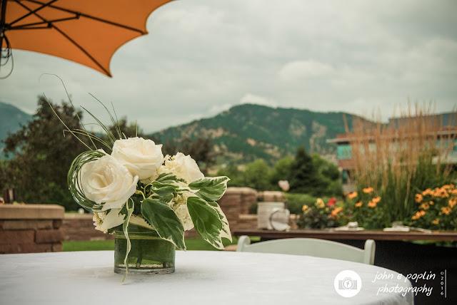 a photograph of a floral centerpiece at a wedding in boulder colorado