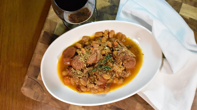 Streamlined Cassoulet with a glass of wine.
