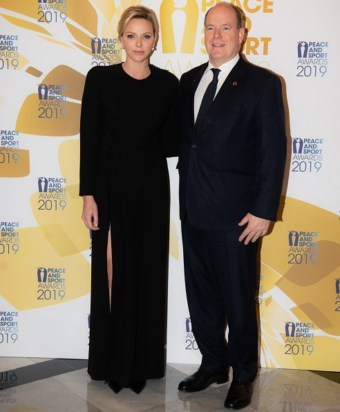 Princess Charlene wore Louis Vuitton long sleeve evening dress