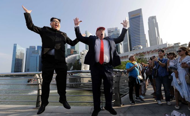 Australian Kim Jong-un impersonator 'detained, questioned' on arrival in Singapore – meets up with Trump lookalike