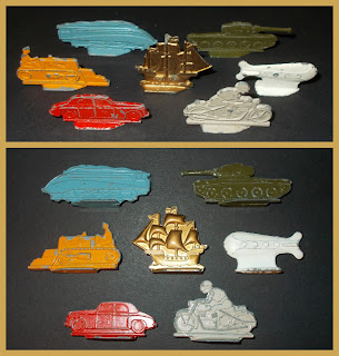 Following the card stand-ups with wooden feet (UK) and composition (US) 'erzatz' playing pieces of the Second World War period, when Waddington's re-vamped the Monopoly set after the war and for a while, they had these die-cast mazak/zamak-alloy flats.