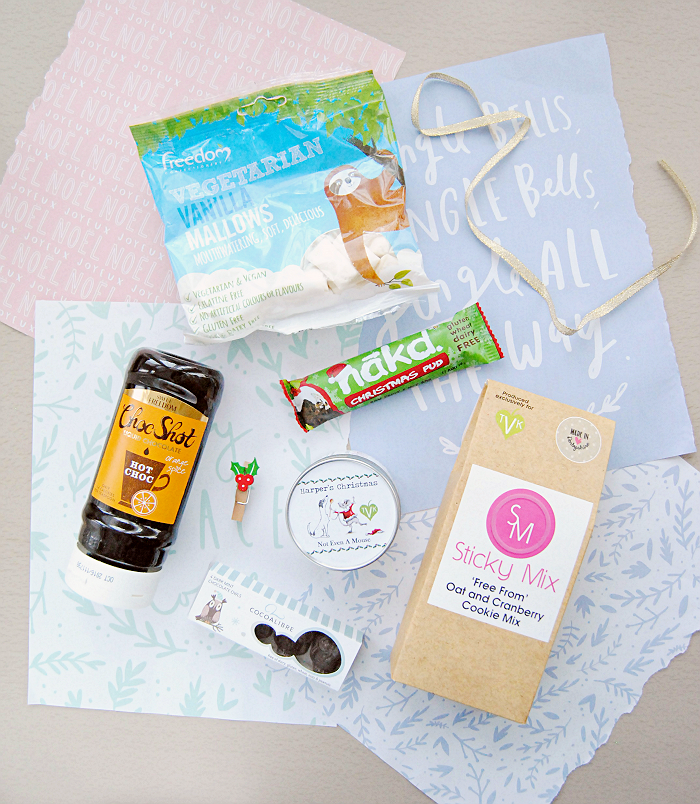 The Vegan Kind December Box on Lovely Witches. Looking for a cruelty-free and vegan subscription box? Read my review of The Vegan Kind and the amazing vegan snacks in this month's box.