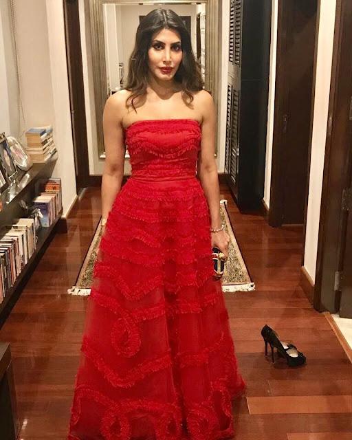 Priya Sachdev in Red Grown