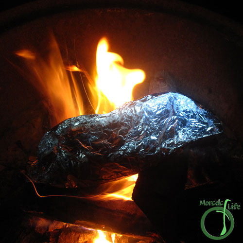 Morsels of Life - Burger and Veggies Foil Pack Step 6 - Place in campfire to cook.