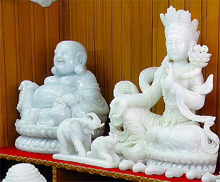 white jade Buddha and deity