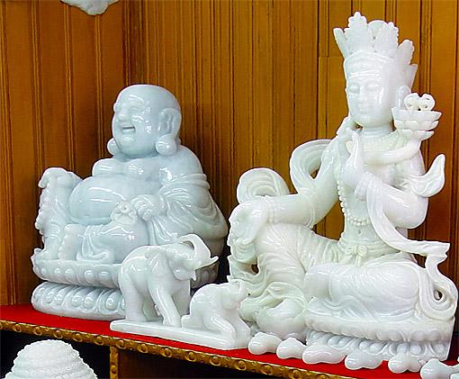 white jade Buddha and deity