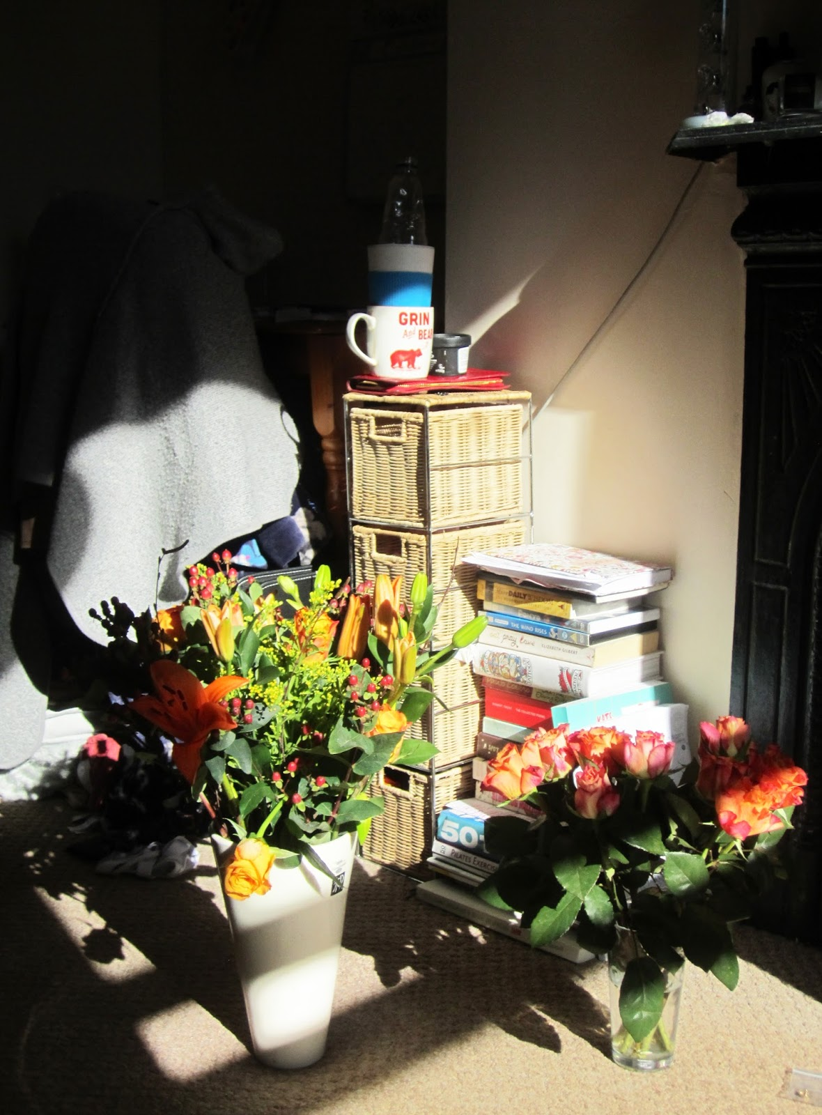 Blossoming Gifts flowers, stack of books
