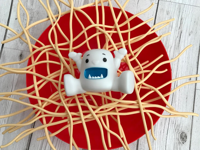 Yeti in My Spaghetti unboxed and ready to play - red bowl, with plastic spaghetti crisscrossed across it and a yeti in the middle