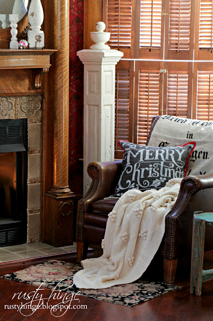 Cozy leather chair with Merry Christmas pillow