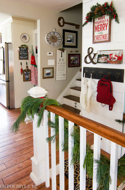 Farmhouse style entryway with shiplap and numbered stairs with Christmas decor