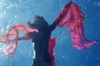 Dancer Delilah (Flynn) crafting her Art, underwater.