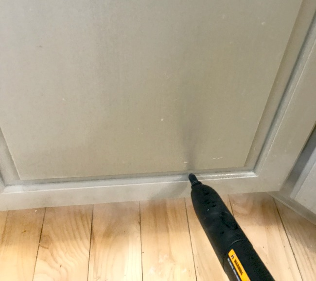 The HomeRight Steam Machine for cleaning kitchen cabinets