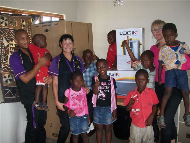 The Hollywoodbets Empangeni team with the children at the iZulu Orphan Project.
