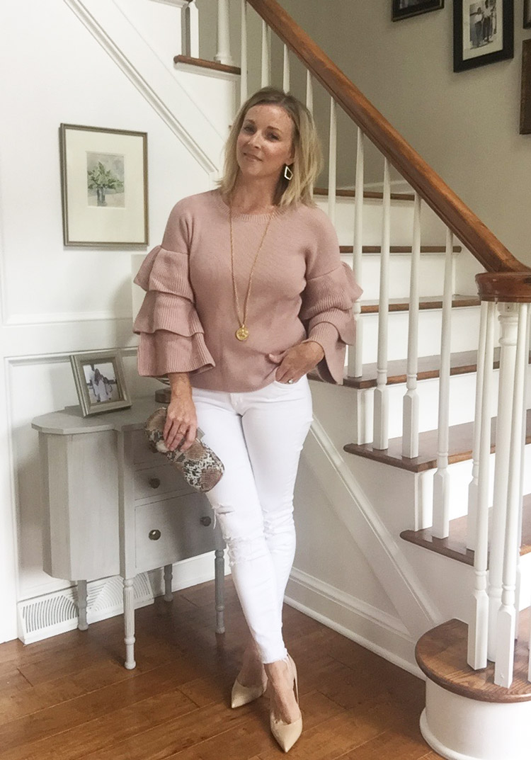 blush bell sleeve sweater with white jeans
