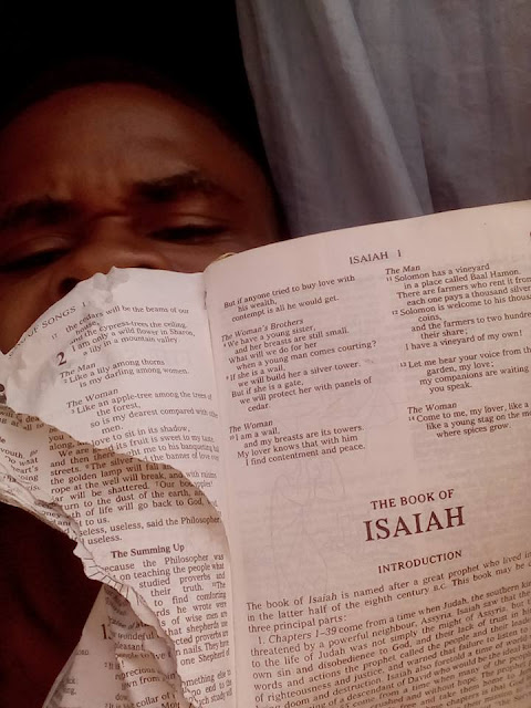 igbo boy tears the bible