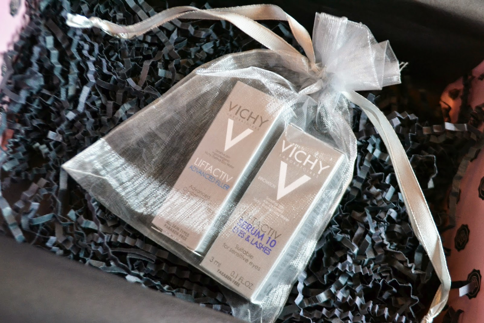 the 2 small boxy of Vichy filler are enclosed in a mostly clear pouch