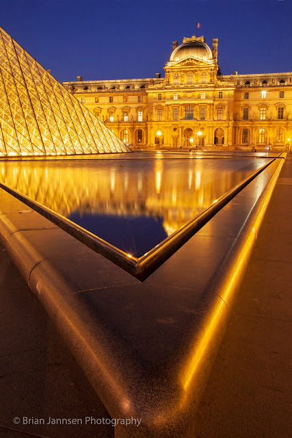 The unmistakable I.M. Pei Louvre pyramid provides a striking contrast to the Renaissance palace facades.
