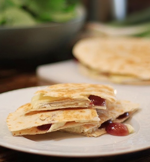 sliced quesadilla on a plate