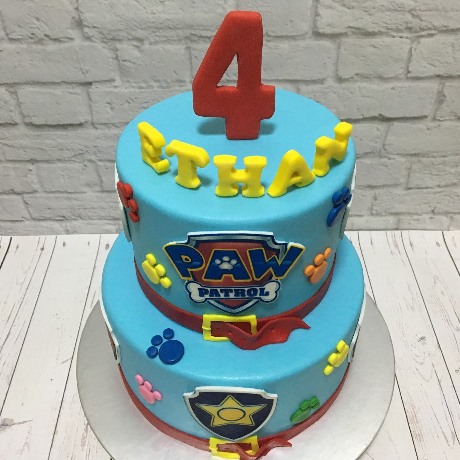 The Top Of Cake Is Decorated With Standing Letters Birthday Boys Name And Also A Big No 4