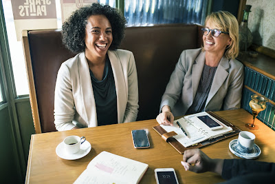 two girls at a business meeting
