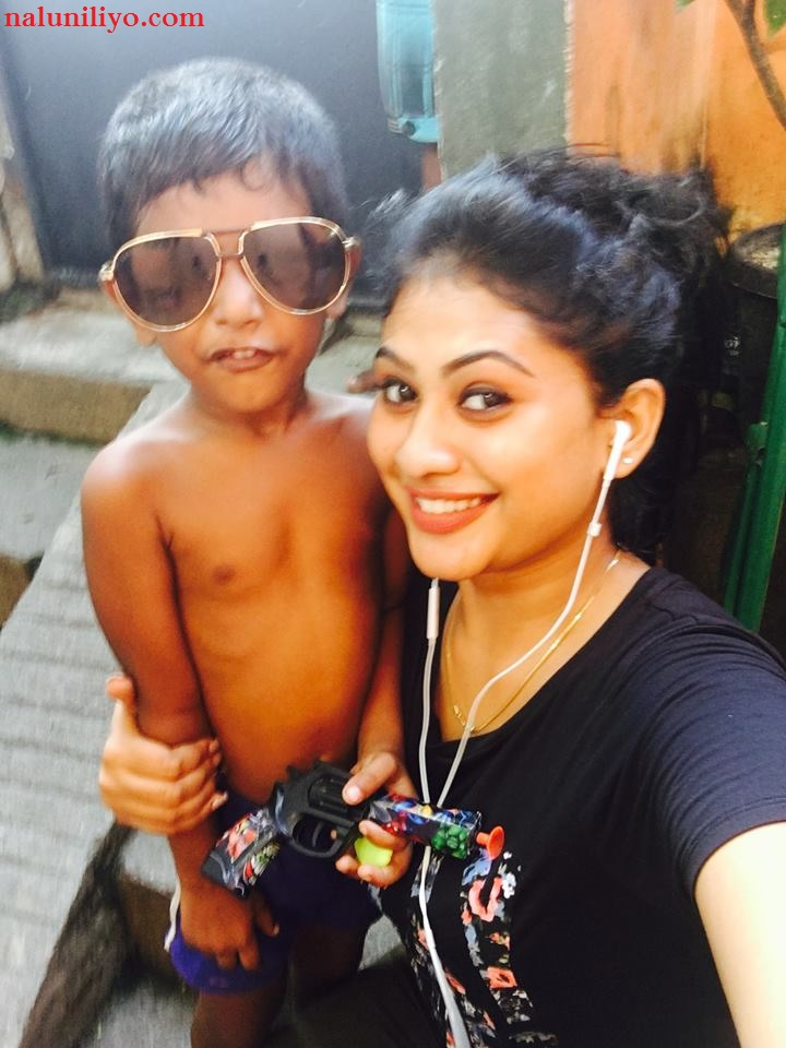 Hot Piumi Hansamali kisses son new