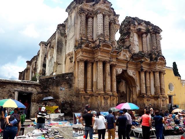 Market outside a crumbling church in Antigua, Guatemala