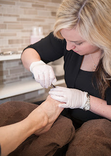 A foot care professional at work Azilda Family Foot Care Azilda, ON