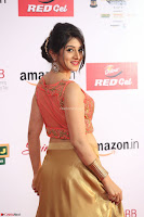 Harshika Ponnacha in orange blouuse brown skirt at Mirchi Music Awards South 2017 ~  Exclusive Celebrities Galleries 013.JPG