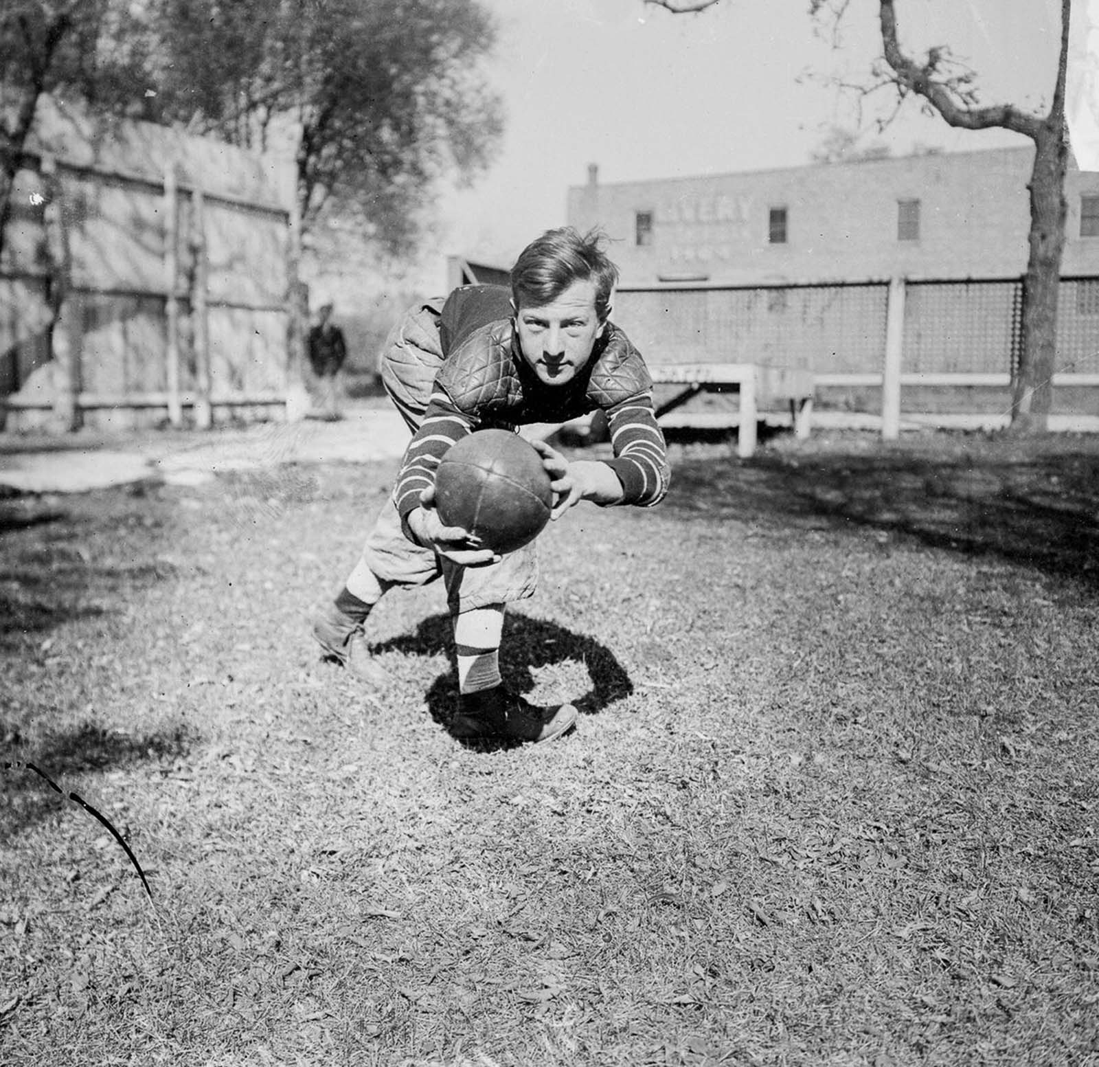 A high school football player in Chicago. 1909.