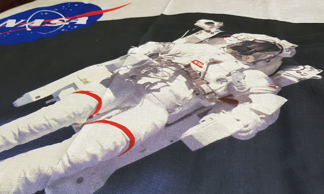 Iconic image of astronaut with Earth behind on bedding