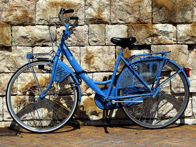 Blue womens bicycle at the Porto Mediceo, Livorno