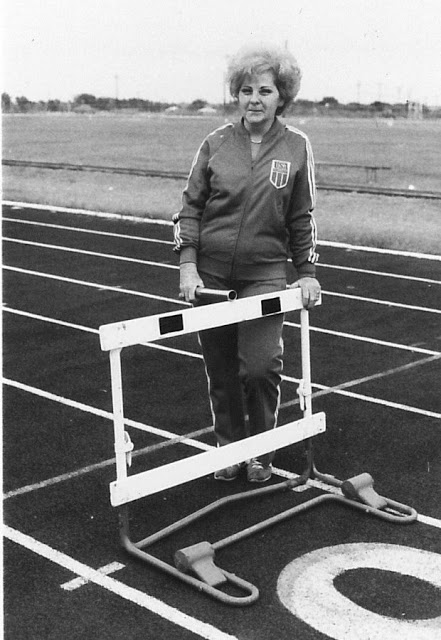 _ Flamin' Mamie, coach of Flamin' Mamie's Bouffant Belles Margaret Ellison, founded the Texas Track Club in 1958