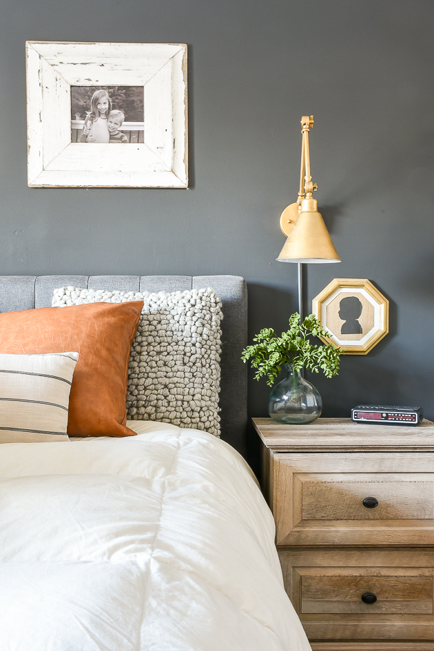 High contrast bedroom painted in Sherwin-Williams Iron Ore and Worldly Gray